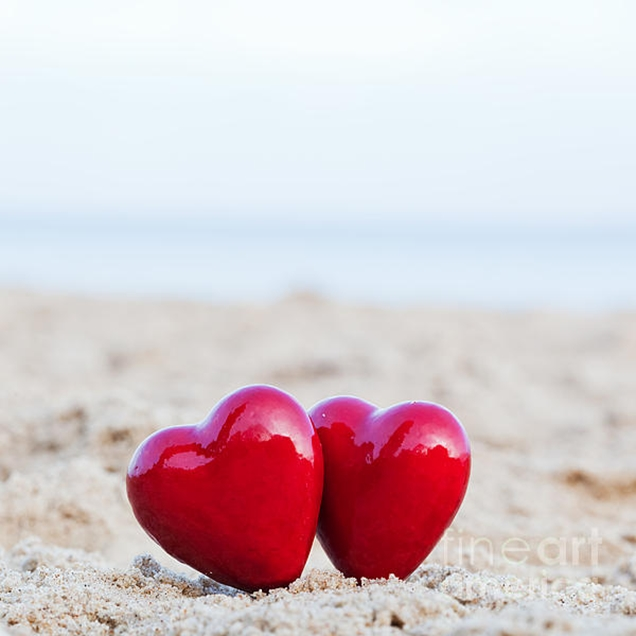 1-two-red-hearts-on-the-beach-symbolizing-love-michal-bednarek