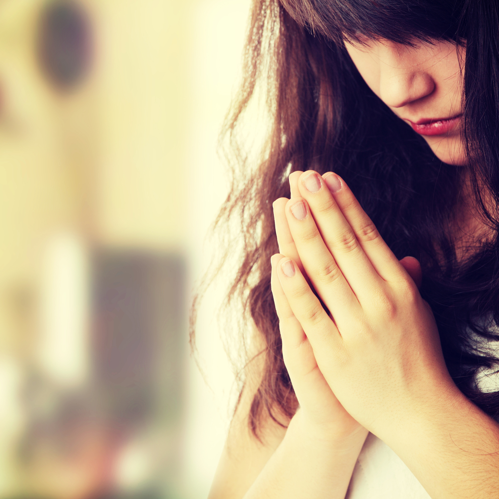 Girl-Praying-shutterstock_177272813